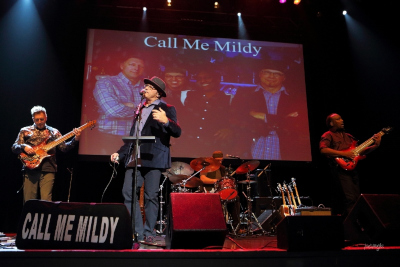 Call Me Mildy band performing onstage.